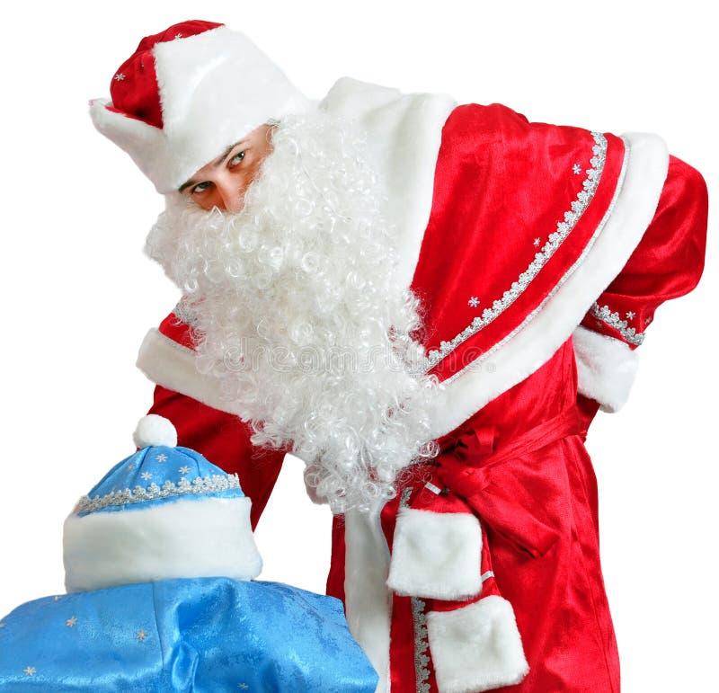 Costume della ragazza della neve e di Santa Claus fotografia stock libera da diritti