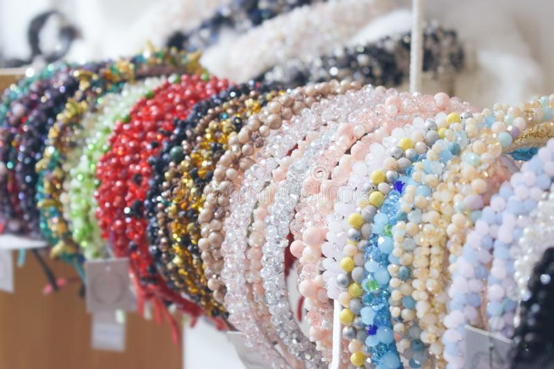 Costume jewelry headbands, handmade accessories. Made of stones, beads and rhinestones. Beautiful multi-colored jewelry on store boutique shop shelves, Treasure royalty free stock image
