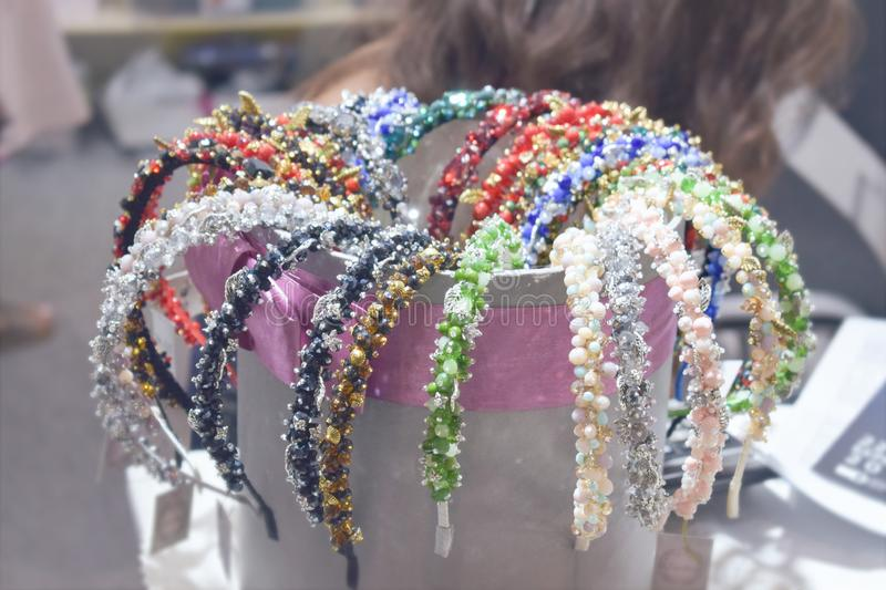 Costume jewelry headbands, handmade accessories. Made of stones, beads and rhinestones. Beautiful multi-colored jewelry on store boutique shop shelves, Treasure royalty free stock photos
