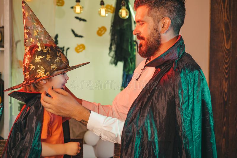 Costume party. Happy Halloween. Father puts his son on Halloween costume. Costume party. Happy Halloween. Father puts his son on Halloween costume stock photography