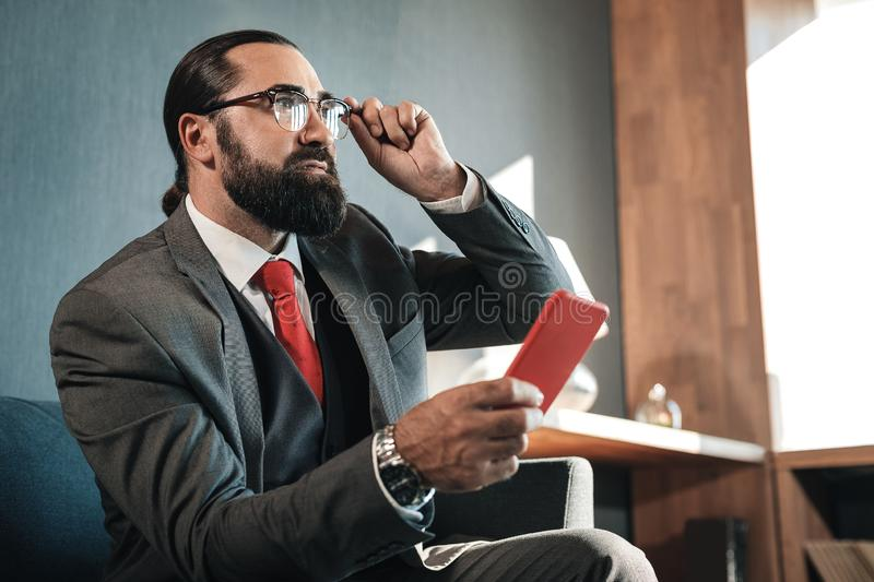 Prosperous man wearing nice business costume and hand watch royalty free stock photo