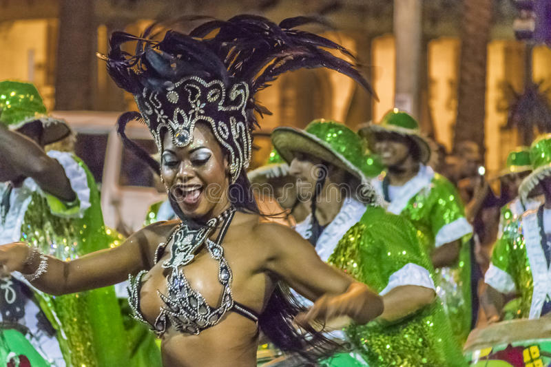 Costumed Attractive Black Woman Dancer at Carnival Parade of Uruguay. MONTEVIDEO, URUGUAY, JANUARY - 2016 - Attractive costumed young black woman dancing and royalty free stock photography