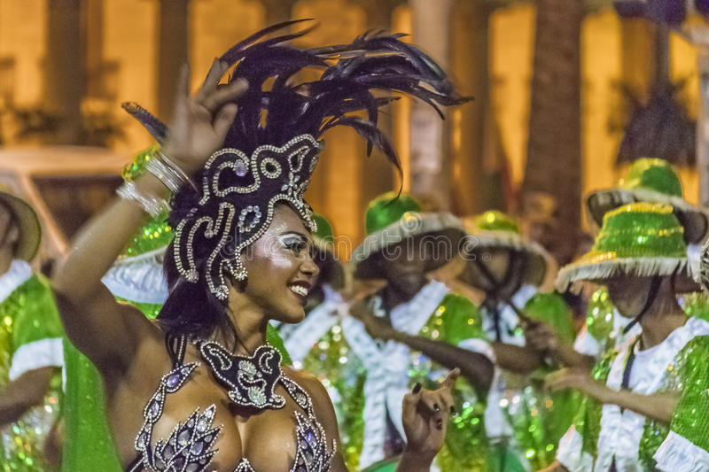 Costumed Attractive Black Woman Dancer at Carnival Parade of Uruguay. MONTEVIDEO, URUGUAY, JANUARY - 2016 - Attractive costumed young black woman dancing and stock photos