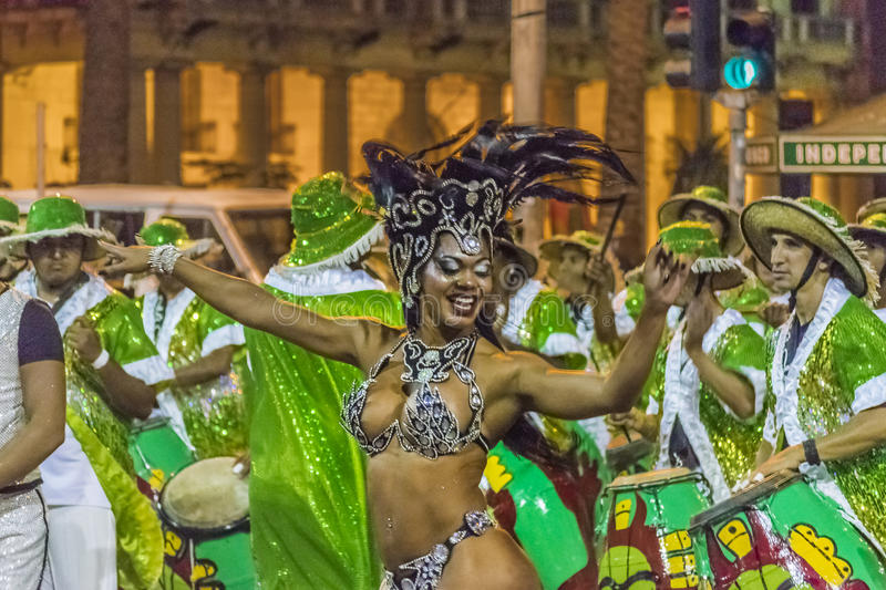 Costumed Attractive Black Woman Dancer at Carnival Parade of Uruguay. MONTEVIDEO, URUGUAY, JANUARY - 2016 - Attractive costumed young black woman dancing and royalty free stock image