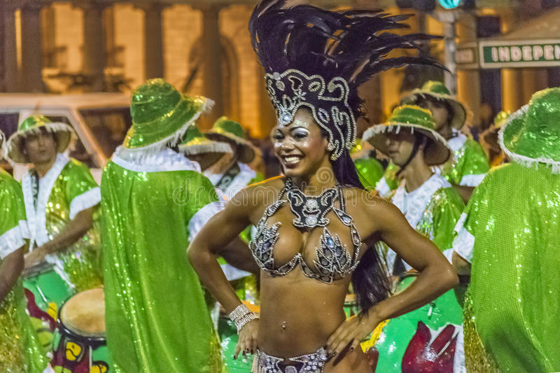 Costumed Attractive Black Woman Dancer at Carnival Parade of Uruguay. MONTEVIDEO, URUGUAY, JANUARY - 2016 - Attractive costumed young black woman dancing and stock photography