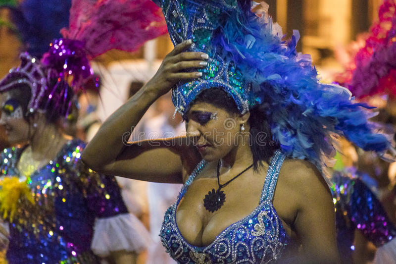 Costumed Attractive Dancer Woman at Carnival Parade of Uruguay. MONTEVIDEO, URUGUAY, JANUARY - 2016 - Close up view of attractive costumed black woman at stock images