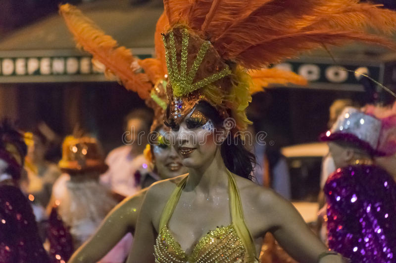 Costumed Attractive Dancer Woman at Carnival Parade of Uruguay. MONTEVIDEO, URUGUAY, JANUARY - 2016 - Attractive costumed woman dancing at inagural parade of stock image