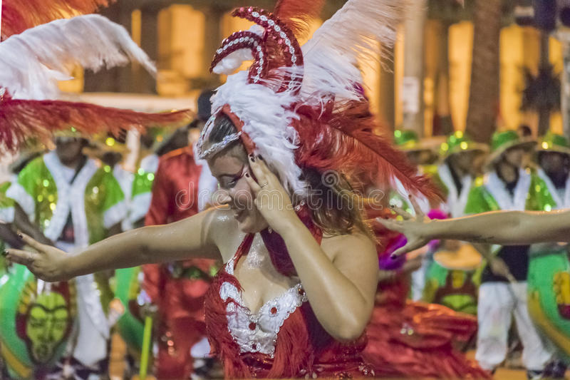 Costumed Attractive Young Woman Dancer at Carnival Parade of Uruguay. MONTEVIDEO, URUGUAY, JANUARY - 2016 - Attractive costumed young woman dancing at inagural stock photos