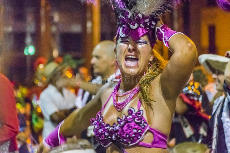 Costumed Dancer Adult Woman at Carnival Parade of Uruguay. MONTEVIDEO, URUGUAY, JANUARY - 2016 - Costumed adult woman dancing at inagural parade of carnival of stock photo