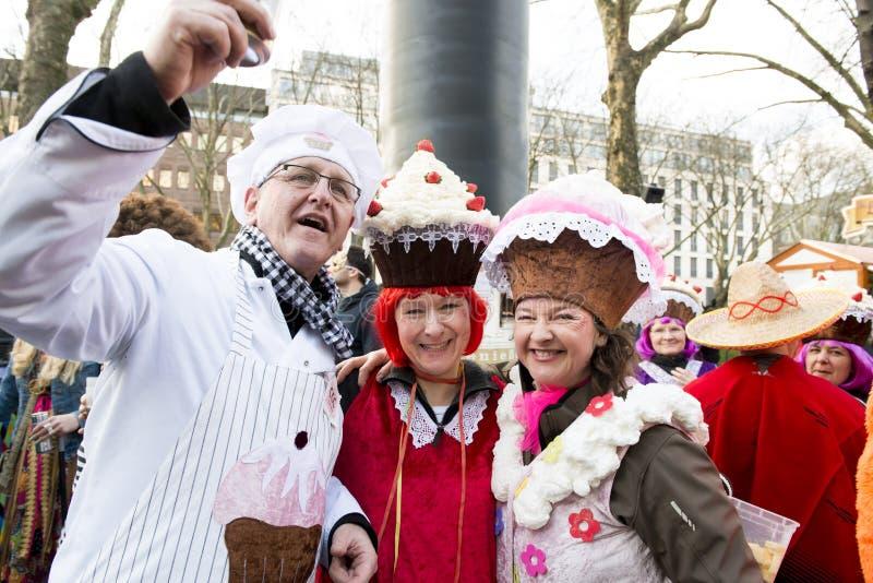 Costumed Cupcakes, Mardi Gras Dusseldorf. People costumed as muffins or cupcakes and baker on street in Duesseldorf, Germany