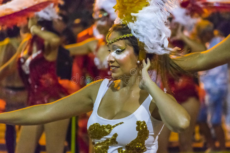 Costumed Young Woman Dancer at Carnival Parade of Uruguay. MONTEVIDEO, URUGUAY, JANUARY - 2016 - Attractive costumed woman dancing at inagural parade of carnival stock image