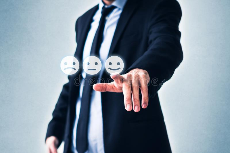 Costumer review concept, man pointing on happy smiling face stock photography