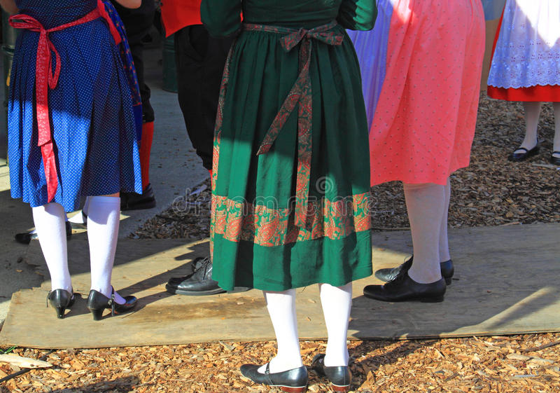 Costumes at Oktoberfest. German traditional costumes at Oktoberfest Festival for Alpine dancing royalty free stock images