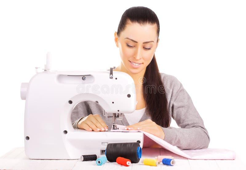 Costura feliz da costureira Isolado no branco fotografia de stock royalty free