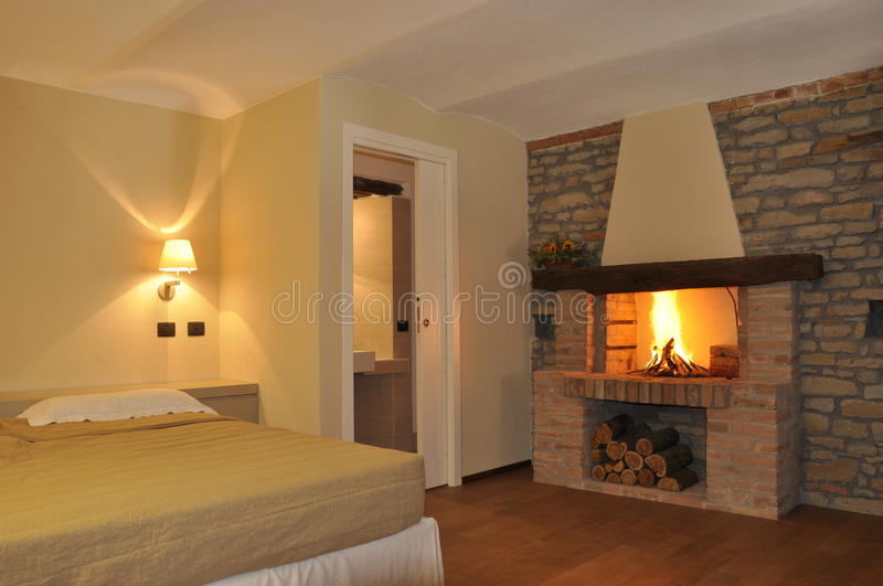 Cosy fire in bedroom stock photo