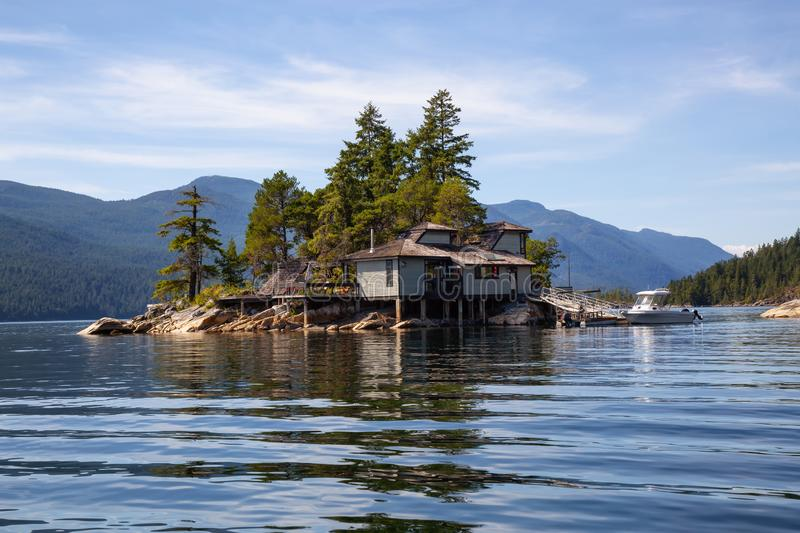 Cosy home on the rocky island in BC royalty free stock photography