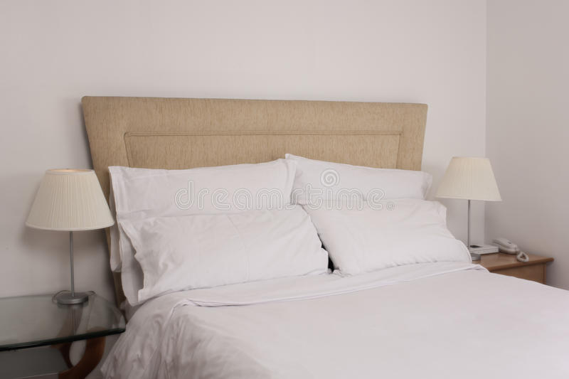 Cosy Hotel Bed stock photography