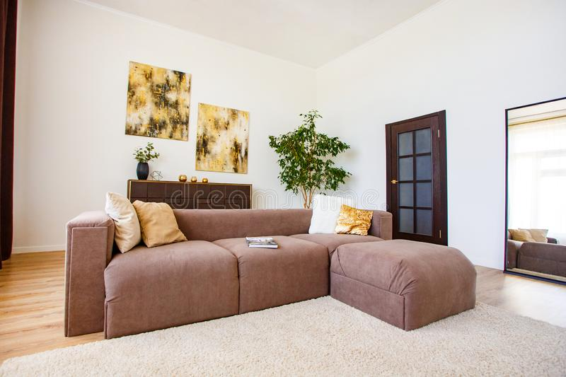 Cosy living room decorated with stylish elements stock images