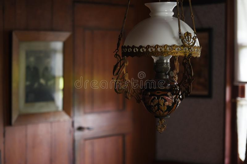 Cosy and old lamp post. Hanging in a warm wooden room stock photo