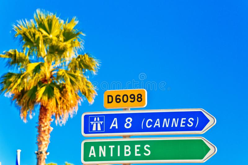 Cote d Azur road sign to Antibes and Cannes stock photos