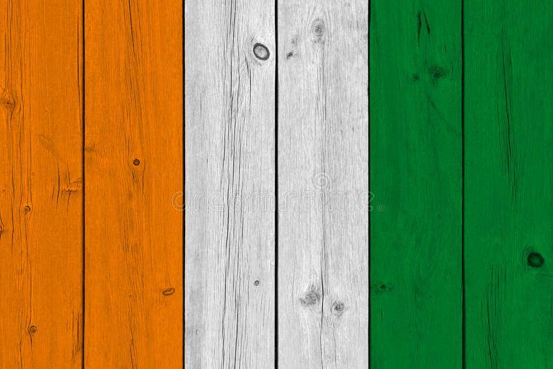 Cote d`ivoire - Ivory Coast flag painted on old wood plank royalty free stock photography