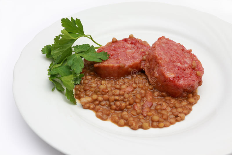 Cotechino with lentils royalty free stock image