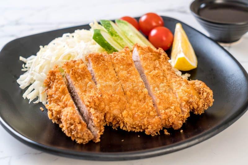 Cotoletta fritta nel grasso bollente giapponese della carne di maiale (insieme di tonkatsu immagini stock