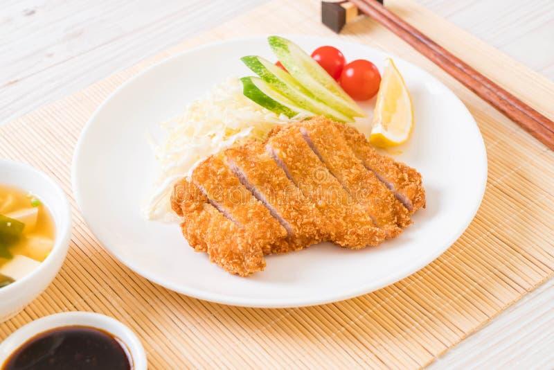 Cotoletta fritta nel grasso bollente giapponese della carne di maiale (insieme di tonkatsu fotografia stock