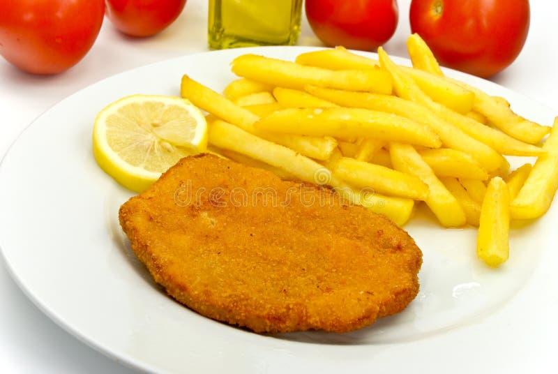 Cotoletta, impanare-con le patate fritte fotografia stock