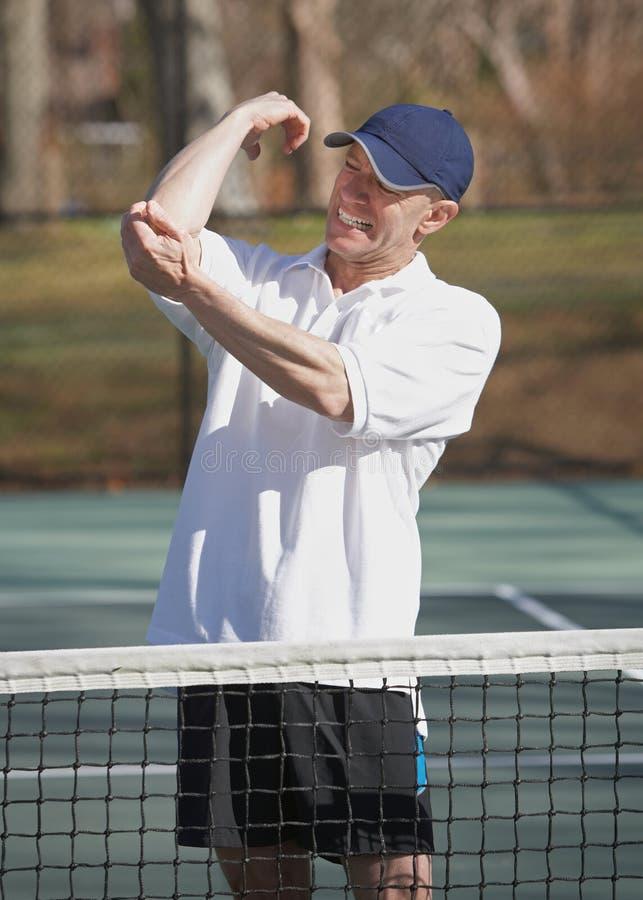 Cotovelo de tênis injuiry fotografia de stock royalty free