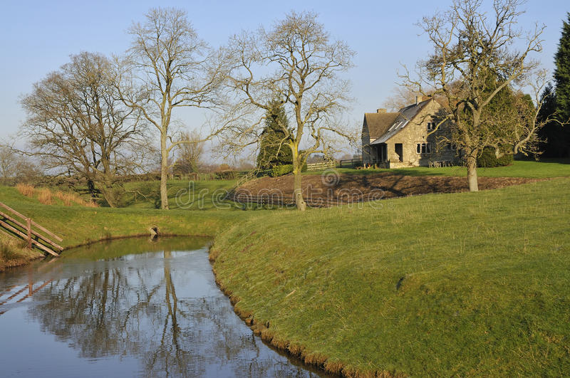 Download Cotswold House by Lake stock photo. Image of british - 12397938