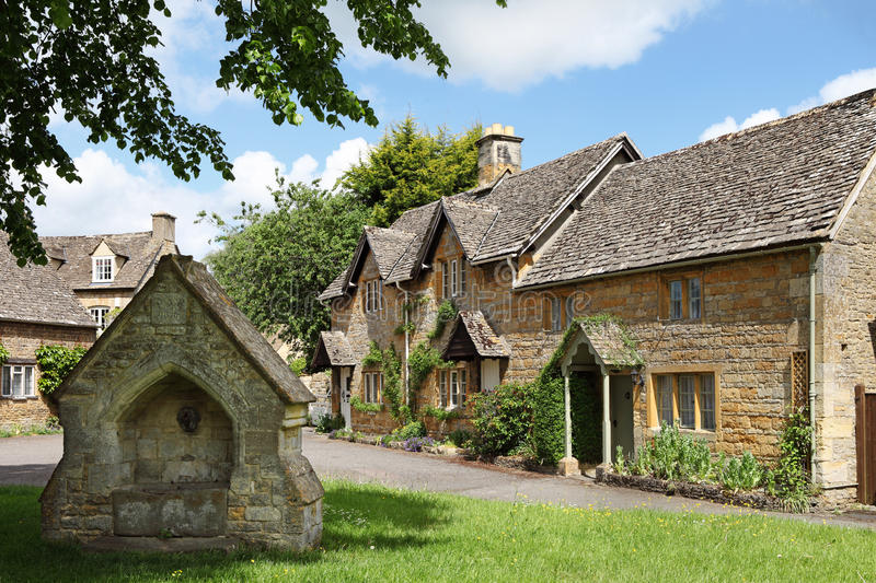 Cotswolds village of Lower Slaughter. View of idyllic Cotswolds village of Lower Slaughter. Featuring water trough in foreground and cottages in background stock photography