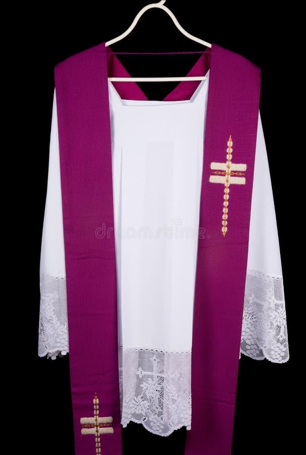 Cotta del sacerdote immagine stock