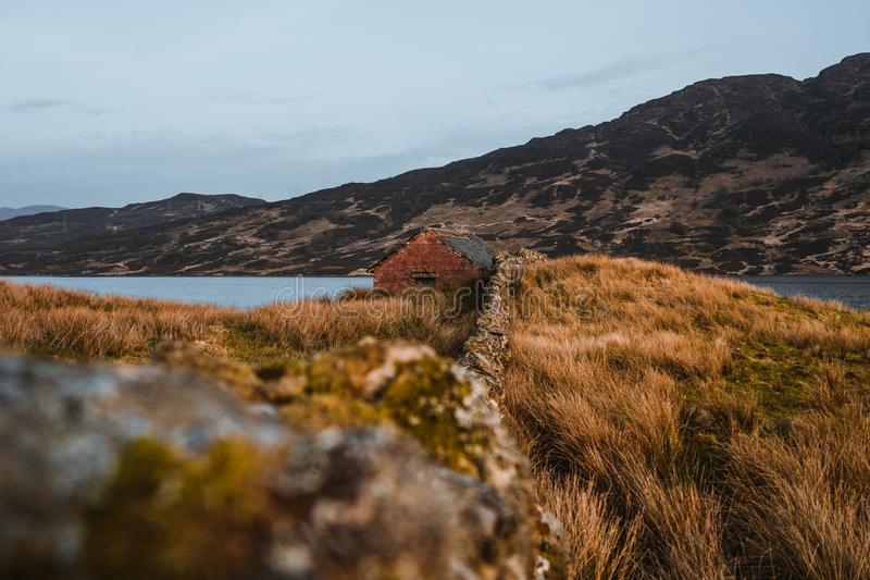 Cottag at loch arklet in Scotland royalty free stock images