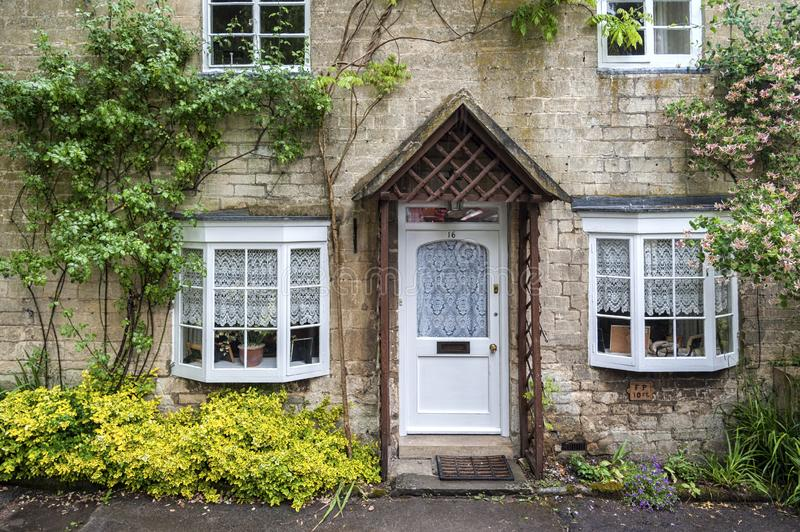 Cottage in the ancient Anglo Saxon town of Winchcombe, Cotswolds, Gloucestershire, England. WINCHCOMBE, ENGLAND -MAY, 25 2018: Cottage in the ancient Anglo Saxon royalty free stock images