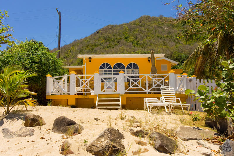 A cottage on the beach in the windward islands. Seaside accommodations as seen at lower bay, bequia royalty free stock photography