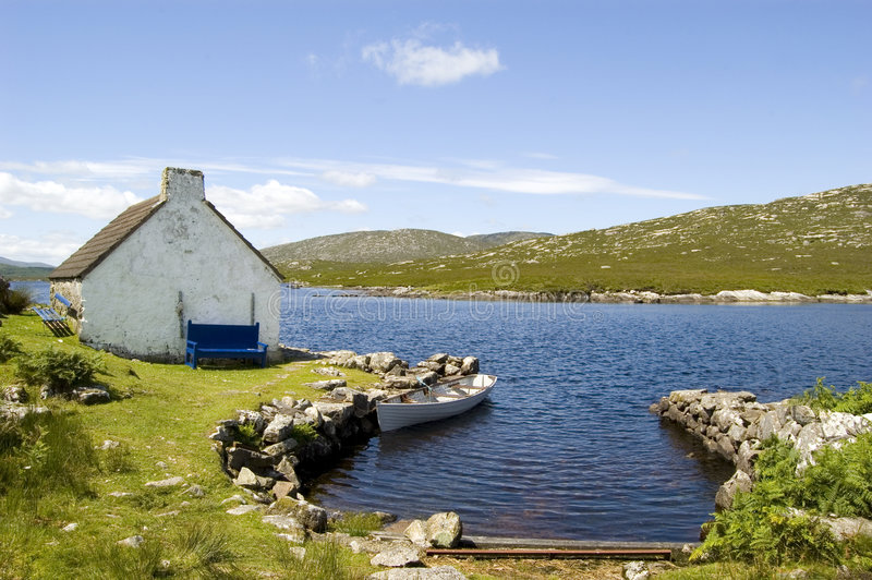 Cottage and boat in Connemara royalty free stock photography