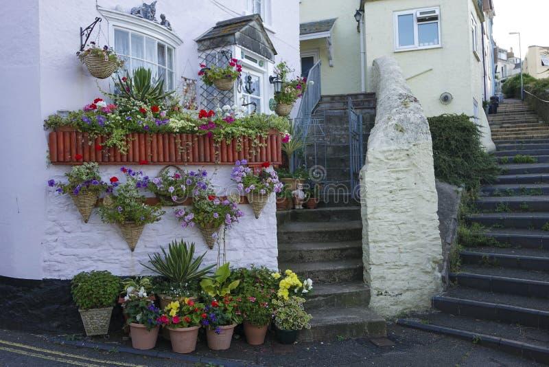 Cottage Brixham Devon England UK. Cottage flowers steps Brixham Devon England UK royalty free stock photo