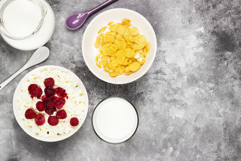 Download Cottage Cheese In Bowl With Frozen Raspberry And Cup Of  Cornflakes, Milk In Glass