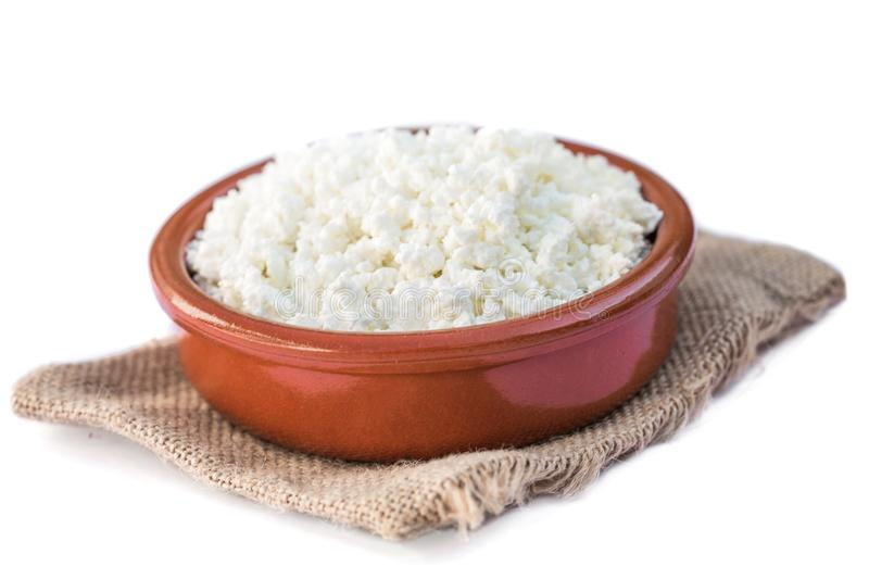Cottage cheese in a bowl isolated on a white background, top vi stock images
