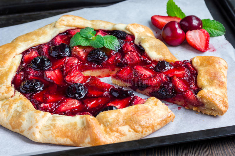Cottage cheese dough galette with strawberry and cherry, horizontal stock photography