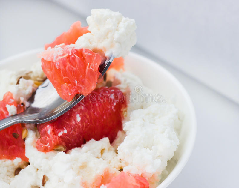 Cottage cheese with grapefruit stock photos