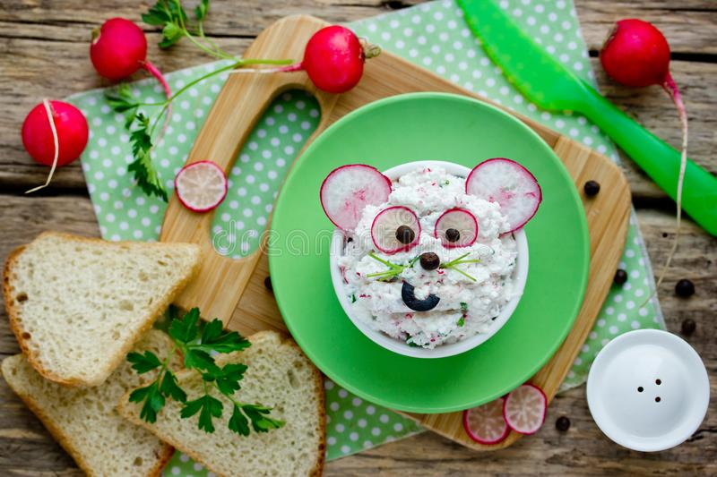 Cottage cheese, green herbs, fresh radish dip appetizer for sandwiches. Fun and healthy food for kids. Mice face shaped cheese snack royalty free stock images