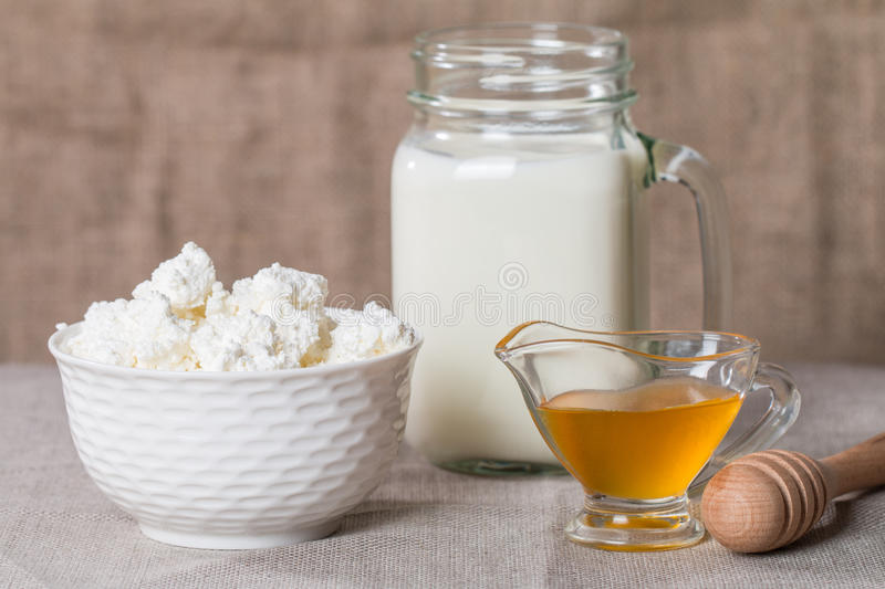 Cottage cheese with milk and honey stock photography