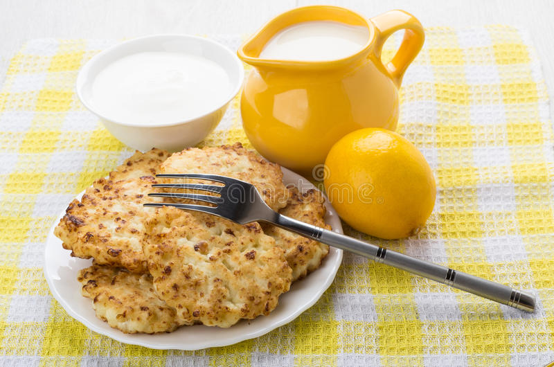 Download Cottage Cheese Pancakes, Bowl With Sour Cream, Lemon And Milk  Stock Photo