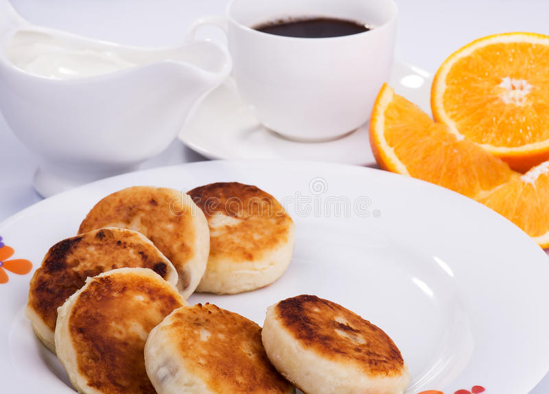 Cottage cheese pancakes with currant jam royalty free stock photos
