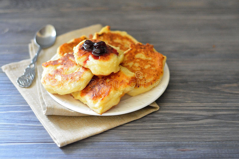 Cottage cheese pancakes with jam stock photos