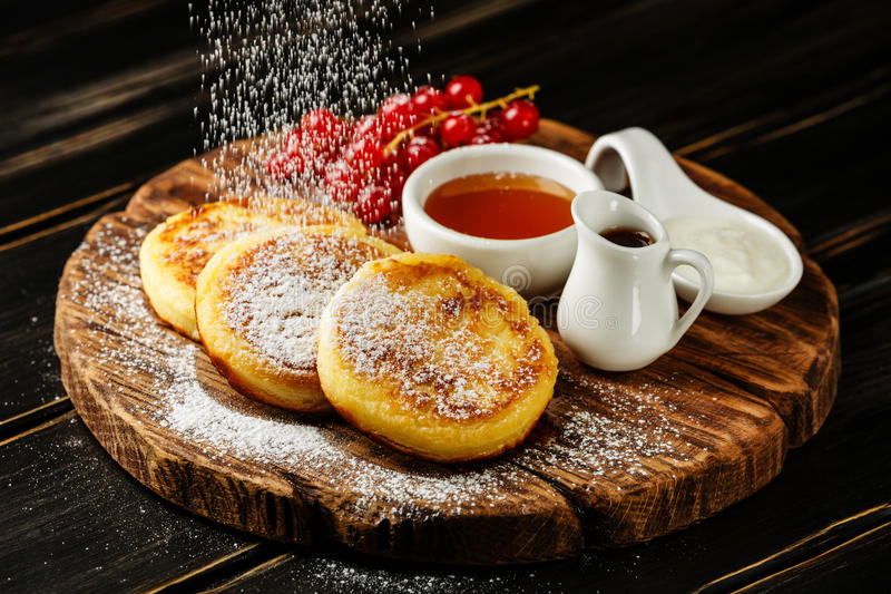 Cottage cheese pancakes with sweet sauces royalty free stock photography