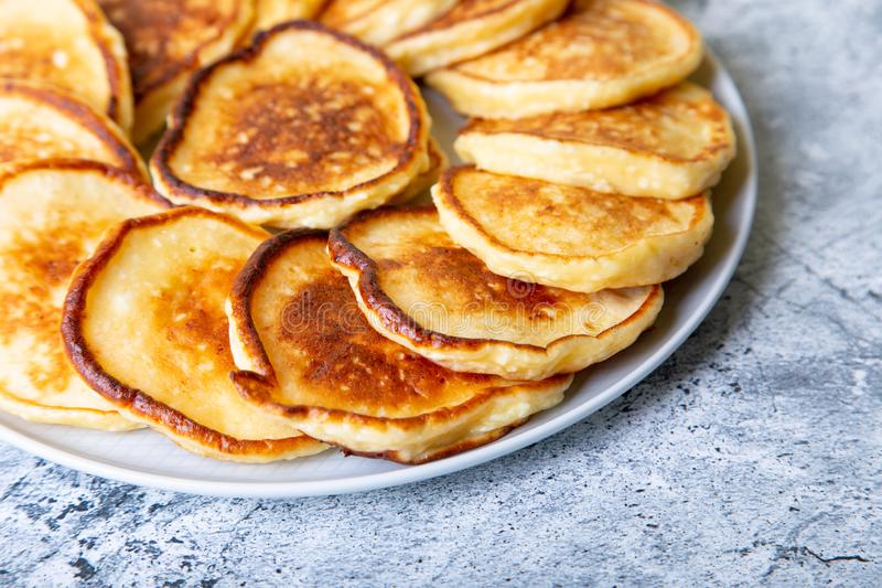 Cottage cheese pancakes syrniki. Homemade cheesecakes from cottage cheese on a large plate. royalty free stock photos