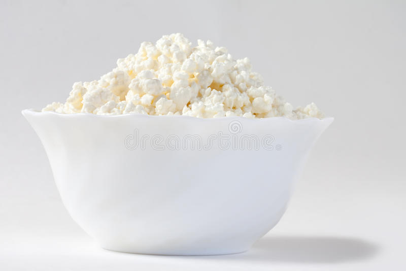 Cottage cheese on a plate royalty free stock images